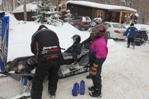 adding oil to a snowmobile