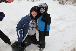 woman and young boy in snowmobiling gear