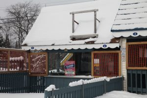 ticket book of theme park, sign says closed for season, snow covering