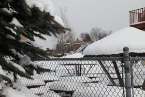 water park ride covered in snow