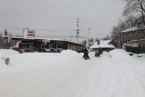ice cream stand with snowmobiles driving by