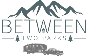 Between Two Parks logo with camper, mountains and trees
