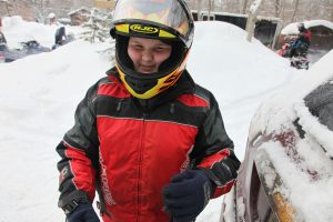 teenage girl in a helmet and jacket