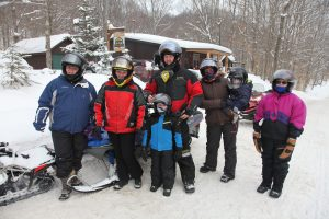 8 people before getting on snowmobiles