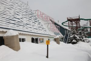 theme park closed for the season, covered in snow