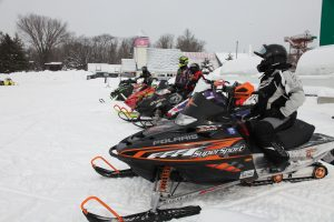 snowmobiles in a row, ready to go