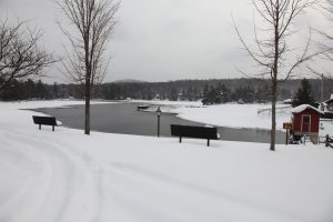 view of old forge pond at the beach, covered in snow