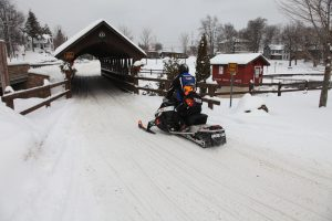 snowmobile covered the historic bridge