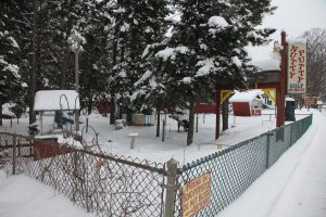 a small miniature golf course under snow